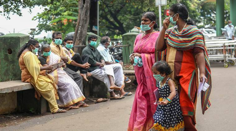 People wear safety masks as a precautionary measure after the 'Nipah' virus outbreak at Kozhikode Medical College in Kerala.