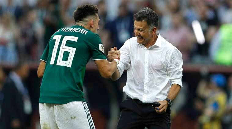 Mexico's Hector Herrera celebrates with Mexico head coach Juan Carlos Osorio, right, at the end of the group F match between Germany and Mexico at the 2018 soccer World Cup in the Luzhniki Stadium in Moscow
