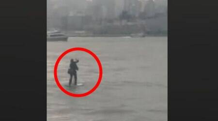VIDEO: Running late! This NYC comedian paddle boards across Hudson river to get to meeting