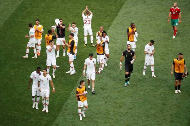Portugal players applaud their fans after the match against Morocco