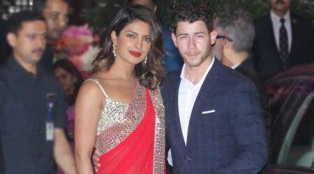 Priyanka Chopra attempts 'Desi girl 2.0' in a red Abu Jani-Sandeep Khosla sari