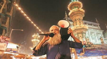 Tradition reigns as men go around waking up the faithful for Sehri