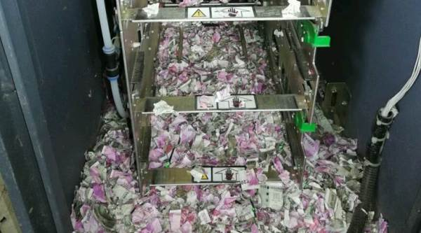 On June 11, when a few repairmen visited the outlet to get the machine fixed, they were surprised to find heaps of 500 and 2000 rupee notes shredded into tiny pieces. (Express photo)