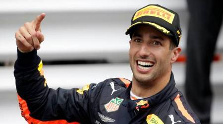 Red Bull driver Daniel Ricciardo of Australia celebrates winning the Formula One race, at the Monaco racetrack, in Monaco
