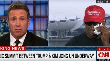 Dennis Rodman (right) cries as he speaks about the meeting between Donald Trump and Kim Jong Un
