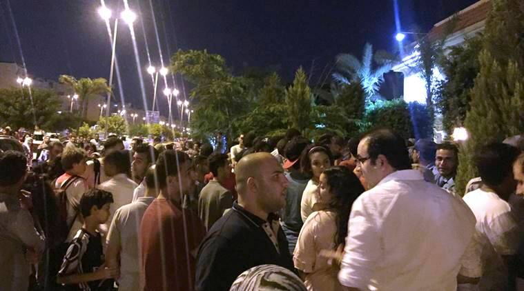 Fans gather outside Egypt's beloved striker Mohamed Salah's home in Madinaty compound, just outside Cairo, Egypt, after his arrival with Egypt's national team from Russia following a disappointing World Cup showing.