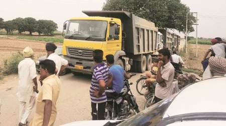 Villagers catch trucks laden with sand in Majri