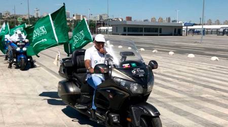 Saudi Arabian biker Ahmed Barnawi and his three companions drive past Rostov Arena on the eve of a World Cup match between Saudi Arabia and Uruguay, in Rostov-on-Don, Russia