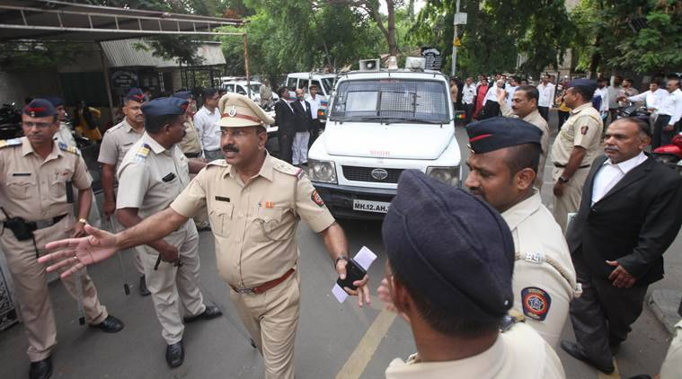 The arrested accused at the Shivajinagar court, in Pune on Thursday (Express Photo/Pavan Khengre)
