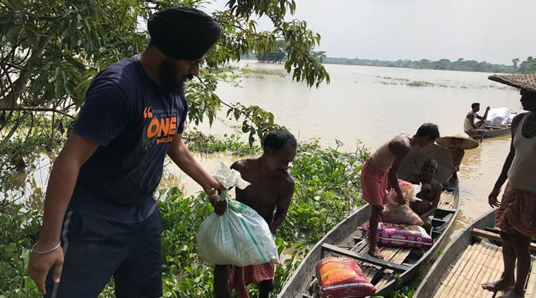 The relief teams are hiring boats from locals to reach the concerned areas and fields that have been completely washed away in flood waters. (Express photo)