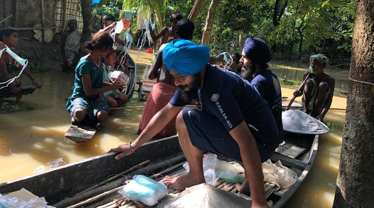 Gurpreet Singh, 24, from Patiala and Japneet Singh, 29, from Ludhiana in Punjab are leading the Khalsa Aid International team in Karimganj district along the India-Bangladesh border. (Express photo)