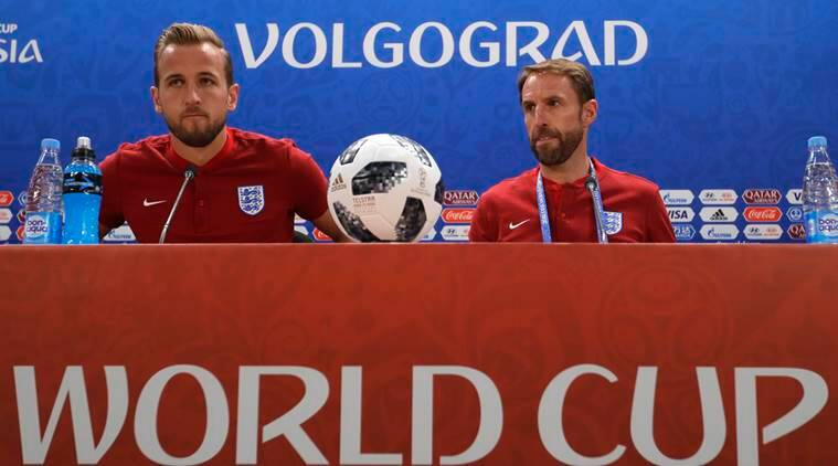 England's Harry Kane, left and England head coach Gareth Southgate arrive for a press conference for the 2018 soccer World Cup, at the Volgograd Arena in Volgograd, Russia