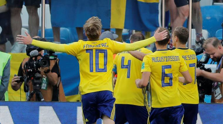 Sweden's Andreas Granqvist celebrates with team mates in front of their fans after scoring their first goal