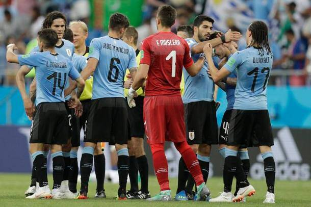 Uruguay's players celebrate after beating Saudi Arabia 1-0 in a group A match at the 2018 soccer World Cup in Rostov Arena in Rostov-on-Don, Russia