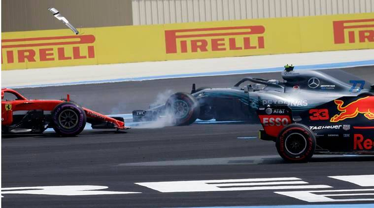 Mercedes driver Valtteri Bottas of Finland, right, spins around after coming into contact with Ferrari driver Sebastian Vettel of Germany, left, during the French Formula One Grand Prix at the Paul Ricard racetrack, in Le Castellet, southern France