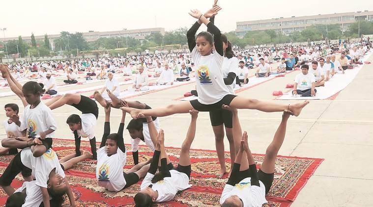 Students of Ashiana Children's Home in Sector 16, Panchkula, perform yoga on Parade Ground on Thursday. (Express photo/Jaipal Singh)