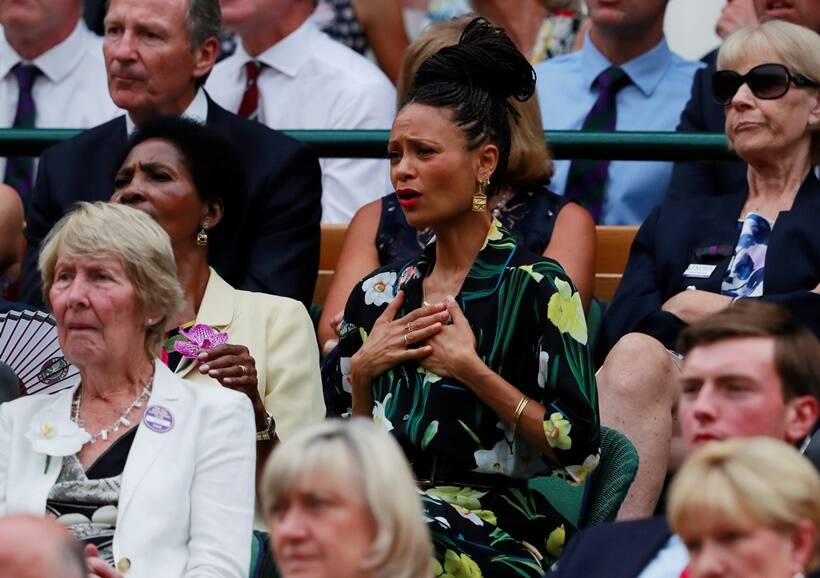 Actress Thandie Newton watches Spain's Rafael Nadal continue his semi final match against Serbia's Novak Djokovic, which was suspended yesterday, after running late.