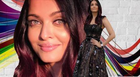 Aishwarya Rai Bachchan is a queen bee in this dazzling black lacy gown