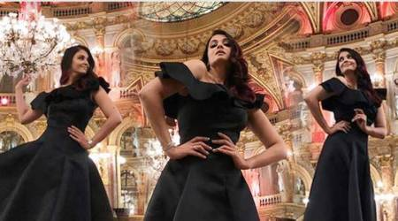 Aishwarya Rai Bachchan is a charmer in this black one-shoulder ballroom dress