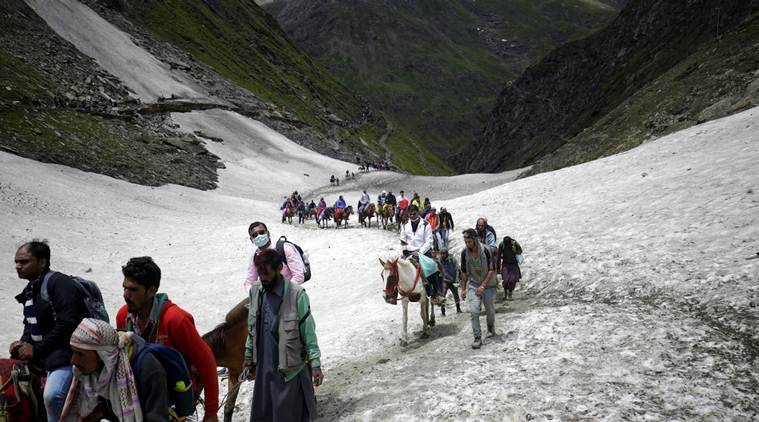 Red flags go up over rains, but Amarnath pilgrims push forward on dangerous 3-km trek