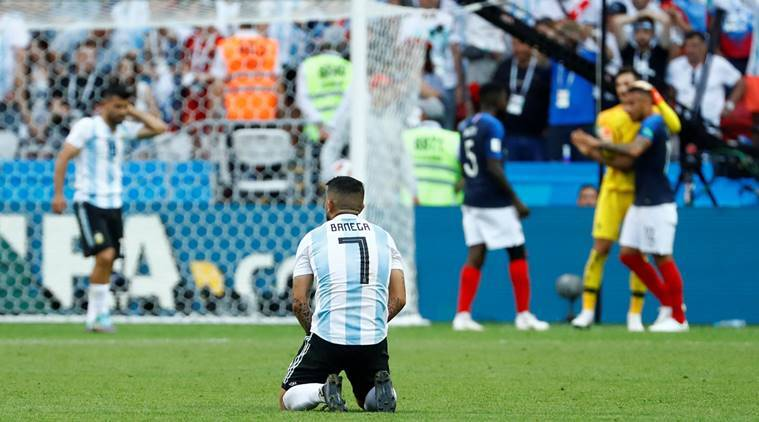 Argentina's Ever Banega looks dejected after the match against France