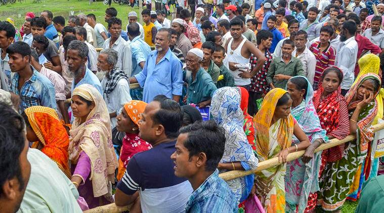 People wait to check their names on the final draft of the state's National Register of Citizens after it was released, at an NRC Seva Kendra in Tezpur on Monday. (PTI)