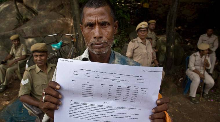 Muhammed Mainuddin, shows his name on a sheet collected from the NRC draft center in Mayoung on Monday. (AP)