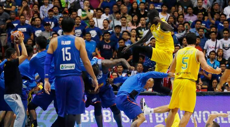 The Philippines players, left and Australian basketball players react, during the FIBA World Cup Qualifiers Monday, July 2, 2018 at the Philippine Arena in suburban Bocaue township, Bulacan province north of Manila, Philippines