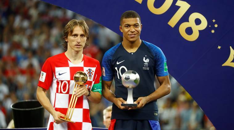 Croatia s Luka Modric poses with the FIFA Golden Ball award as France s  Kylian Mbappe poses with the FIFA Young Player award. (Source  Reuters) 4b6a6a00c