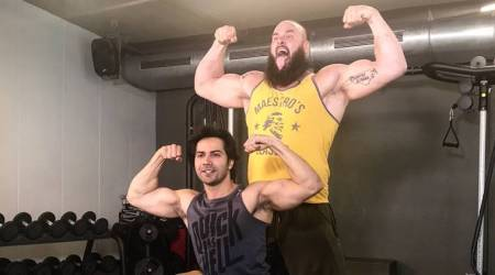 WWE Superstar Braun Strowman arrives in India, flexes muscle with Varun Dhawan; see pics