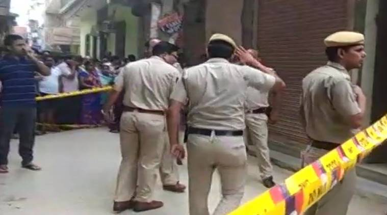 Blindfolded and bound bodies found hanging at family home in New Delhi