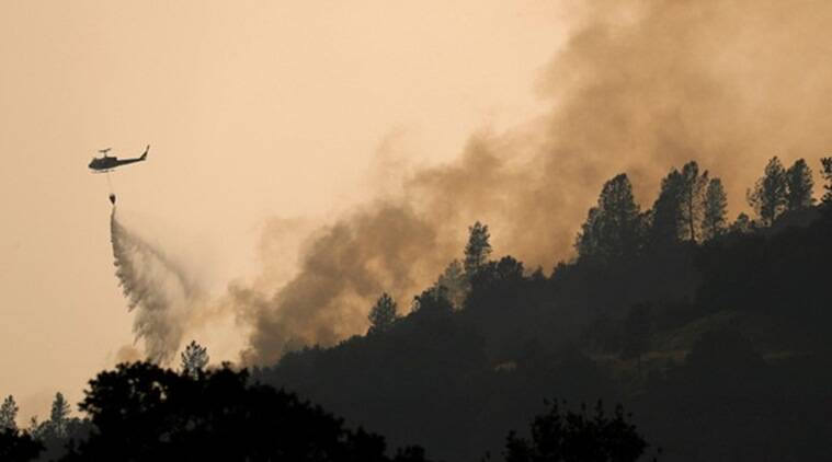 California wildfire kills 2, burns firefighters