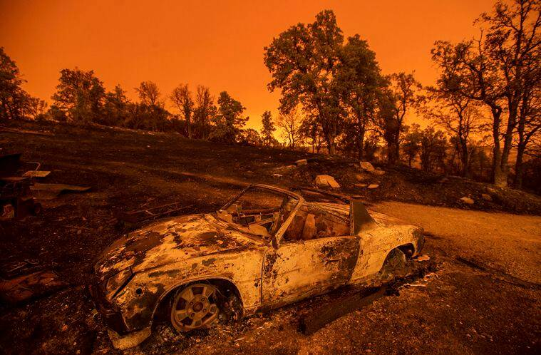 Cars scorched by the Carr Fire rest at a residence in Redding Calif. on Friday