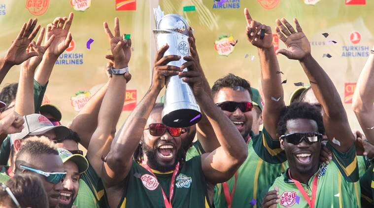 Vancouver Knights' Chris Gayle holds up the trophy after his team defeated the West Indies B Team in their final of the Global T20 Canada cricket tournament in King City, Ontario