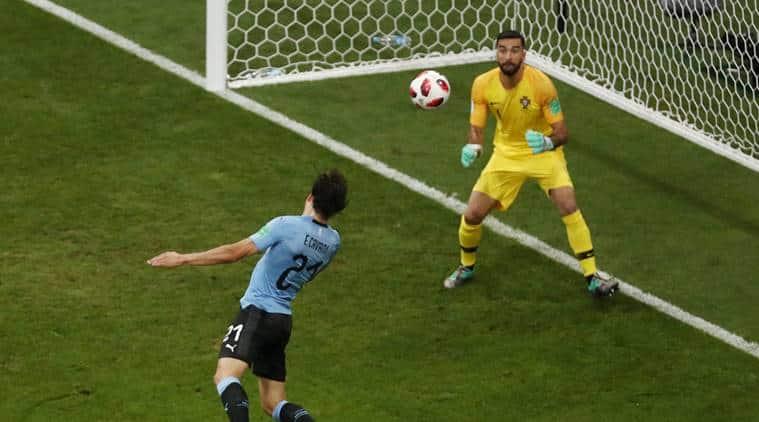 Uruguay's Edinson Cavani scores their first goal past Portugal's Rui Patricio