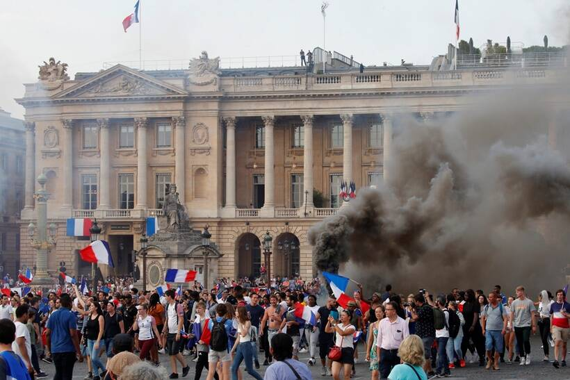 France fans celebrate on the Place de la Concorde after France win the Soccer World Cup final.