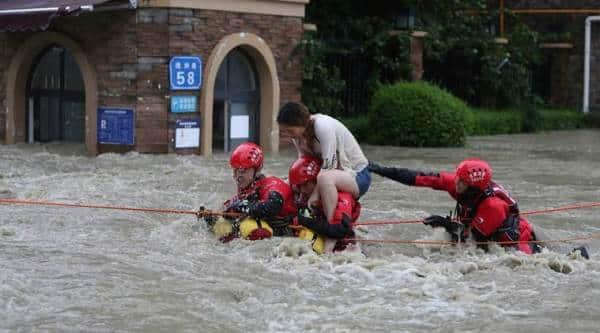 China floods wreak havoc, block roads and railways; more rain due