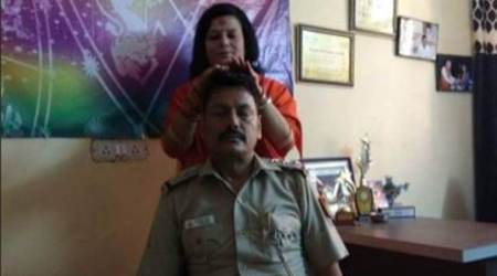 Delhi policeman seen taking blessings from godwoman, transferred
