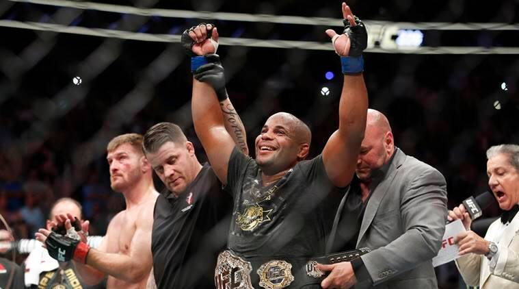 Daniel Cormier celebrates after defeating Stipe Miocic in a heavyweight title mixed martial arts bout at UFC 226, Saturday, July 7, 2018, in Las Vegas