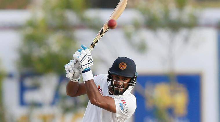 Karunaratne sets record, Sri Lanka makes 287