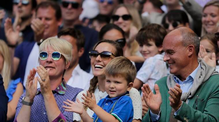 Jelena Djokovic, wife of Novak Djokovic of Serbia and their son applaud after the men's singles final match against Kevin Anderson of South Africa at the Wimbledon Tennis Championships