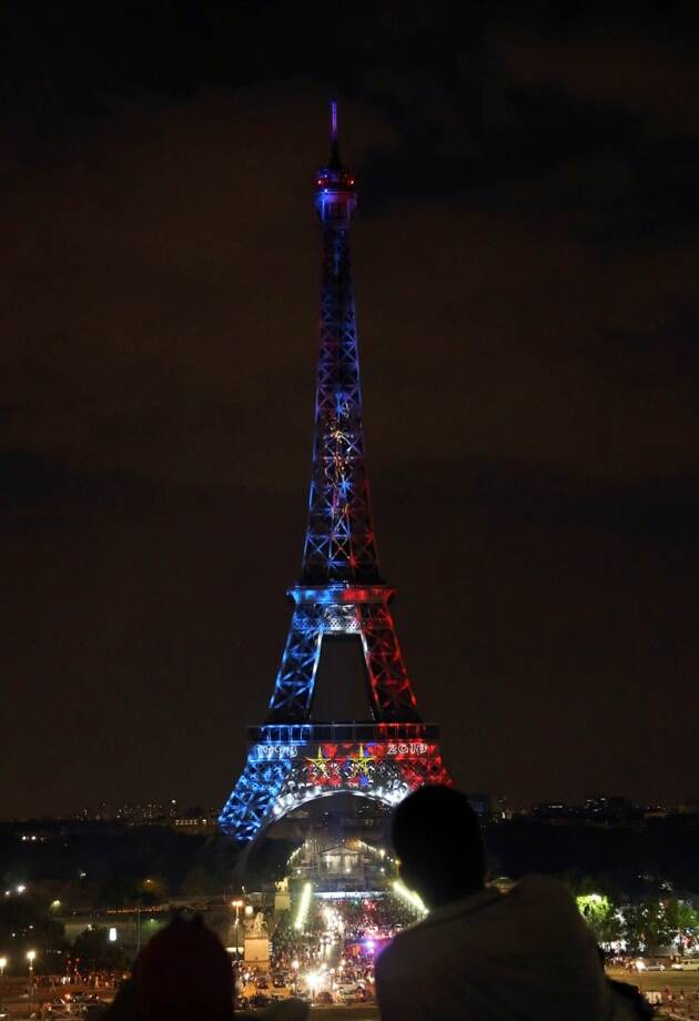 The Eiffel Tower is illuminated with the colors of France after France won the World Cup final between France and Croatia