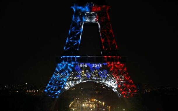 The Eiffel Tower is illuminated with the colors of France and the years of the soccer World Cup wins after France won the World Cup final between France and Croatia