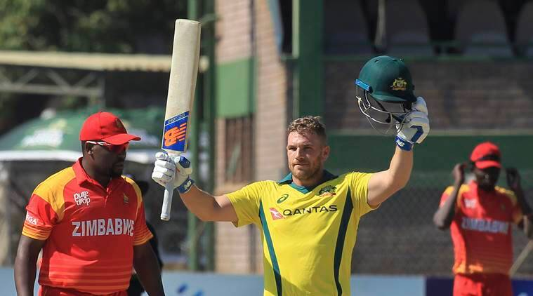 Australian batsman Aaron Finch celebrates scoring 100 during the T20 cricket match against Zimbabwe at Harare Sports Club, in Harare, Zimbabwe