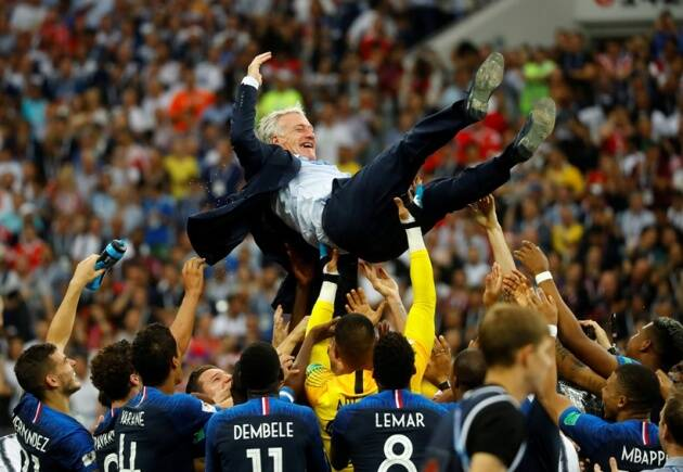 France players celebrate winning the World Cup with coach Didier Deschamps