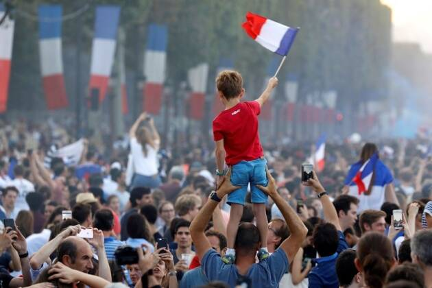 France fans celebrate on the Champs-Elysees avenue after France win