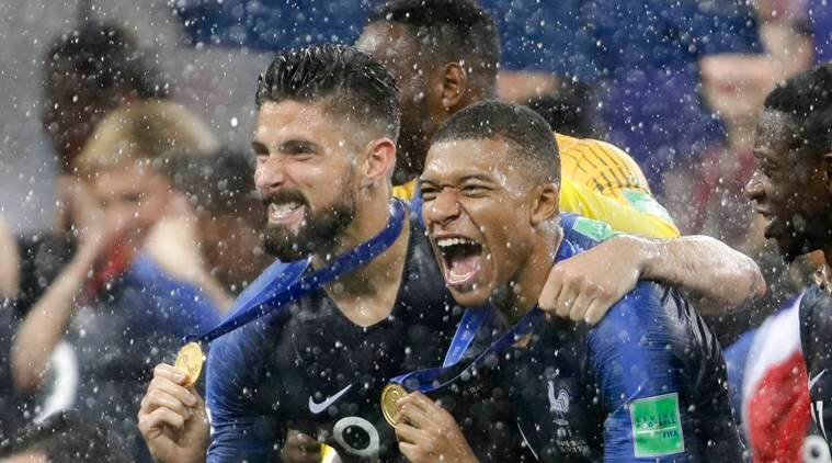 France's Kylian Mbappe, right, and teammate Olivier Giroud celebrates after the final match between France and Croatia at the 2018 soccer World Cup in the Luzhniki Stadium in Moscow, Russia