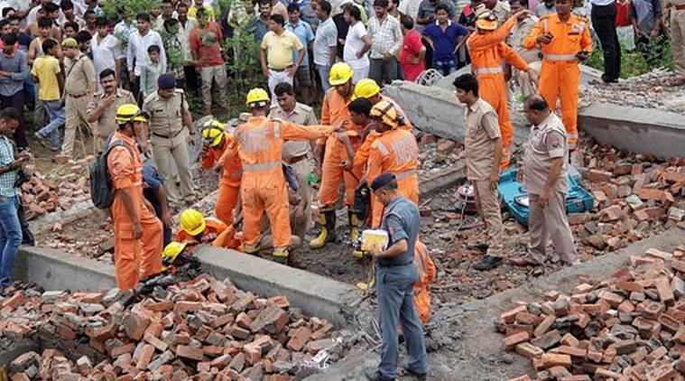 Rescue works underway after an under-construction building collapsed in Ghaziabad on Sunday. (PTI)