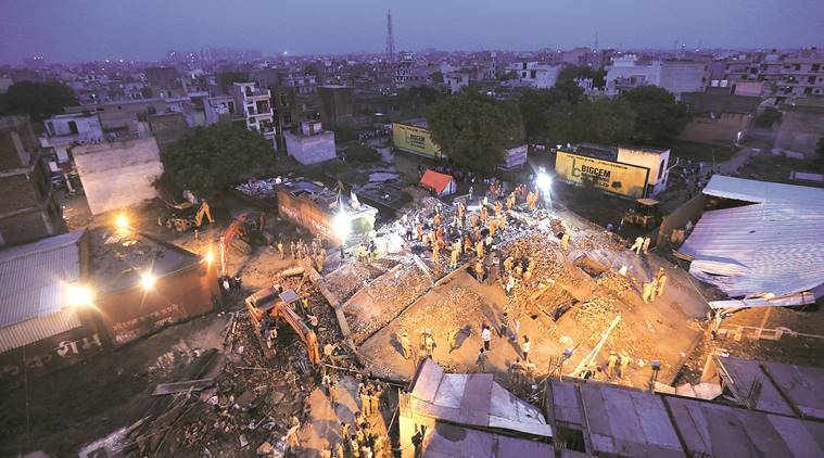 The under-construction building in Ghaziabad's Misal Garhi collapsed on Sunday. (Express photo/Gajendra Yadav)