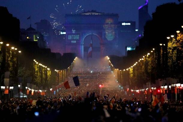 The name of French soccer striker Antoine Griezmann is projected onto the Arc de Triomphe after France won the soccer World Cup final match between France and Croatia